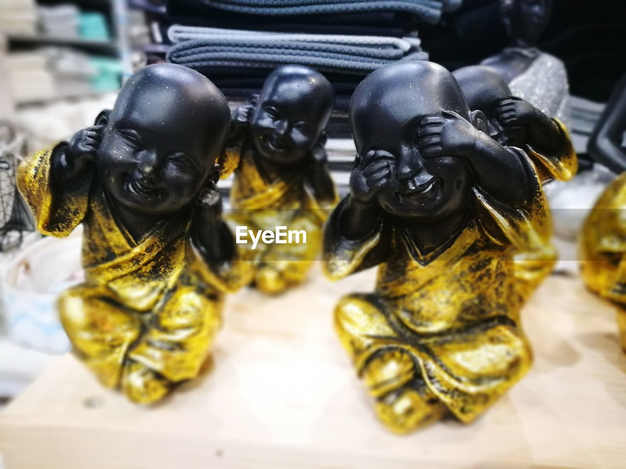 CLOSE-UP OF STATUES IN SHOP