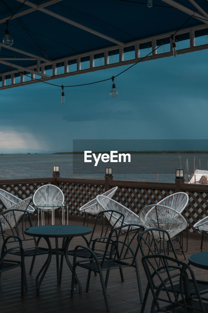 chair, seat, table, water, sea, sky, restaurant, horizon, horizon over water, nature, absence, empty, no people, architecture, business, day, beauty in nature, cafe, food and drink, outdoors, setting