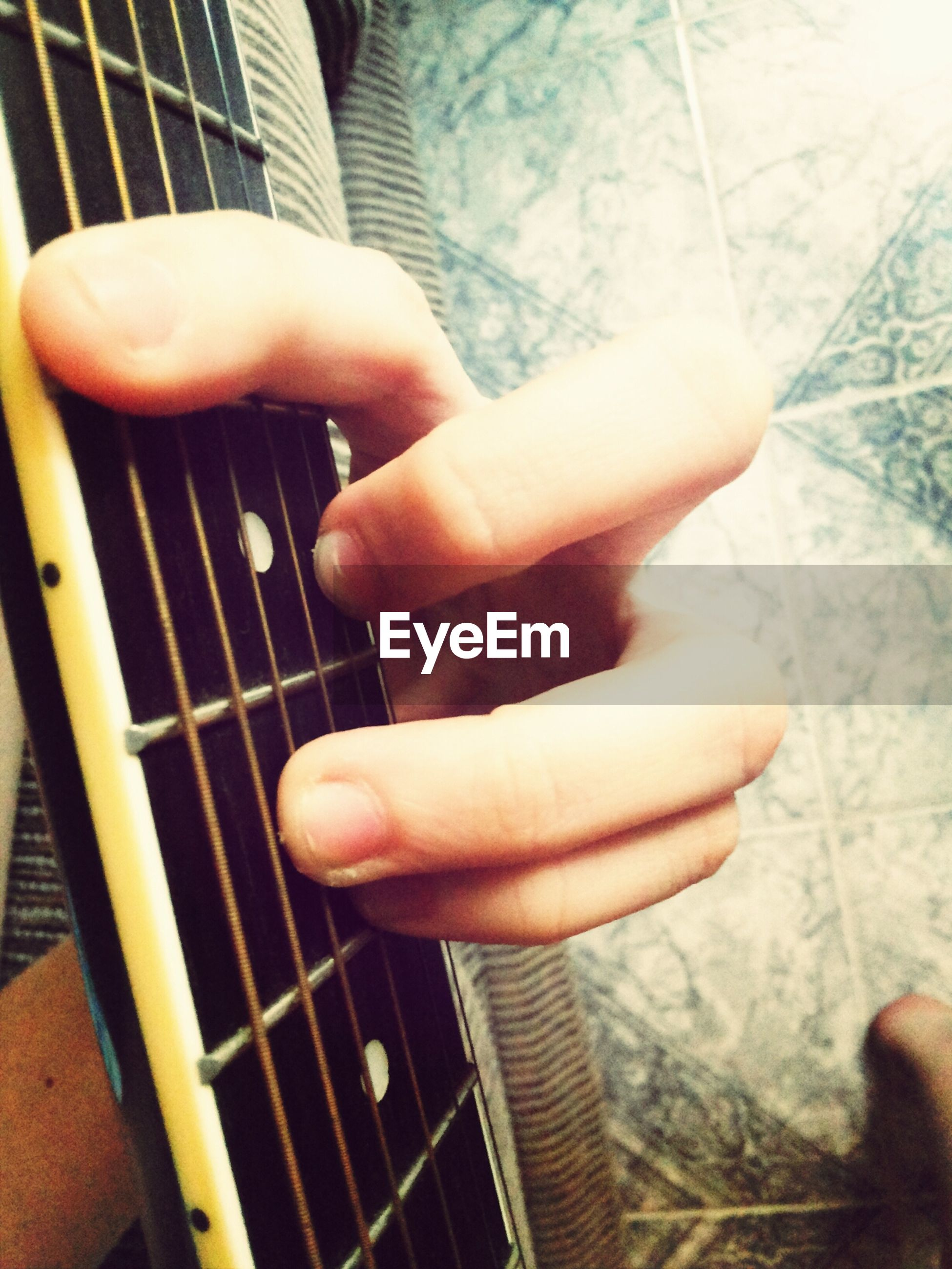 person, part of, indoors, lifestyles, human finger, cropped, holding, leisure activity, unrecognizable person, men, close-up, musical instrument, touching, personal perspective, music, focus on foreground