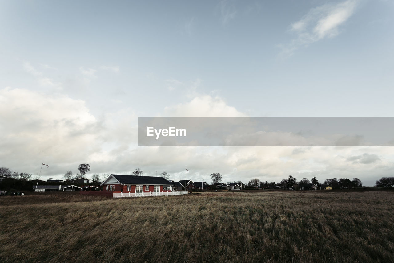 sky, field, cloud - sky, land, landscape, environment, built structure, architecture, plant, building exterior, nature, building, house, rural scene, agriculture, tranquil scene, farm, day, beauty in nature, scenics - nature, no people, outdoors