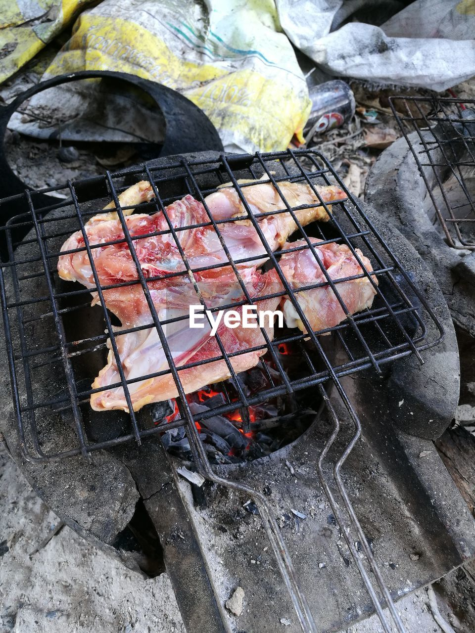 barbecue, heat - temperature, barbecue grill, meat, burning, preparation, food, grilled, food and drink, coal, fire, no people, fire - natural phenomenon, flame, preparing food, high angle view, outdoors, day, freshness, nature