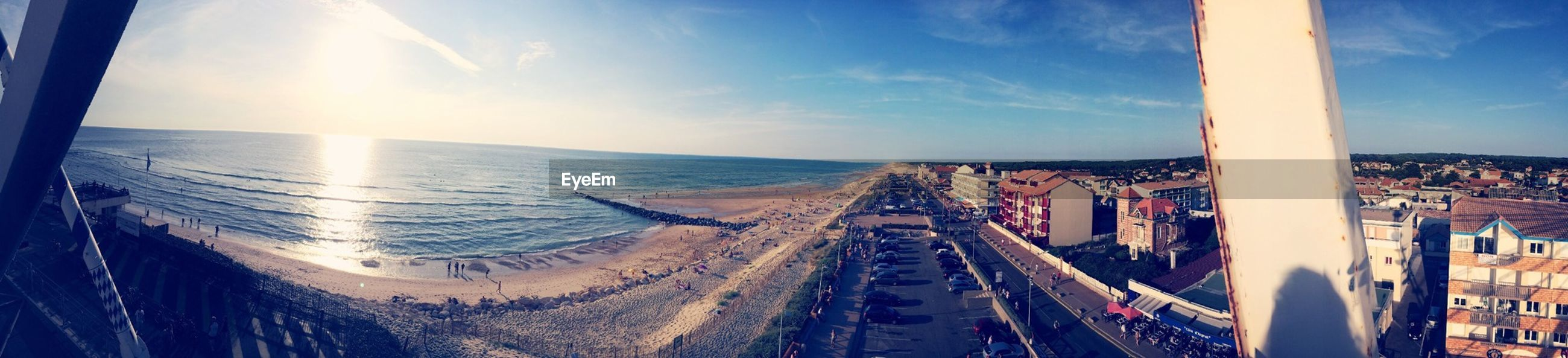 sea, horizon over water, water, sky, beach, transportation, sunset, shore, panoramic, sunlight, scenics, nature, beauty in nature, cloud - sky, incidental people, sun, blue, tranquility, tranquil scene, travel