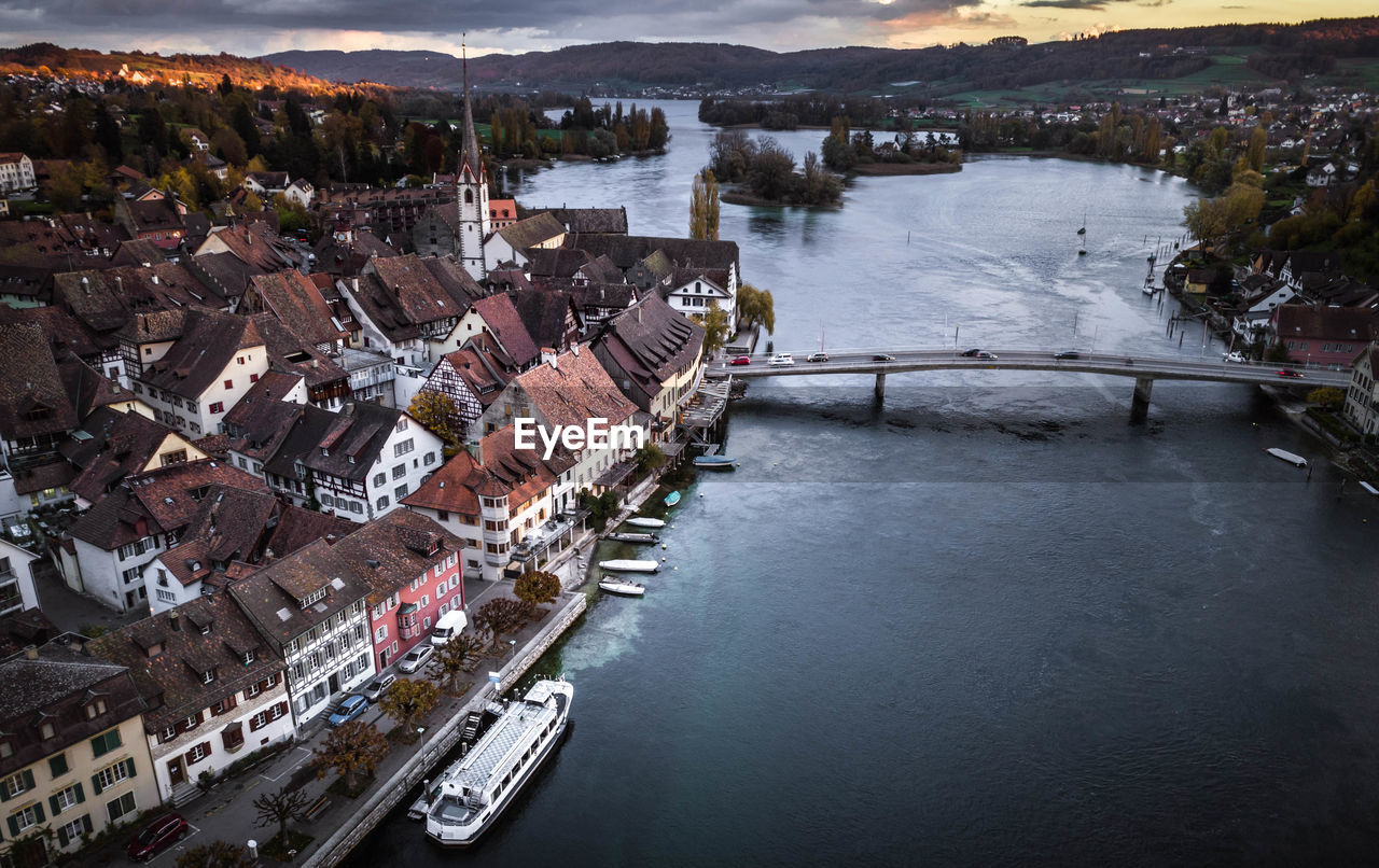 water, architecture, building exterior, high angle view, river, built structure, outdoors, town, no people, day, nautical vessel, nature, city, sky