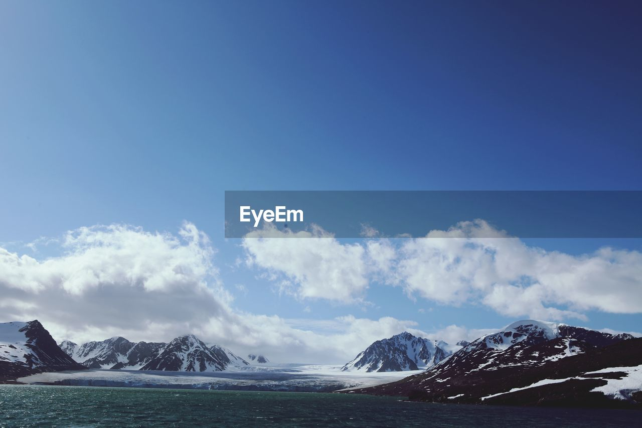 sky, scenics - nature, beauty in nature, mountain, winter, cold temperature, cloud - sky, tranquil scene, snow, tranquility, non-urban scene, snowcapped mountain, mountain range, day, nature, environment, no people, landscape, idyllic, outdoors