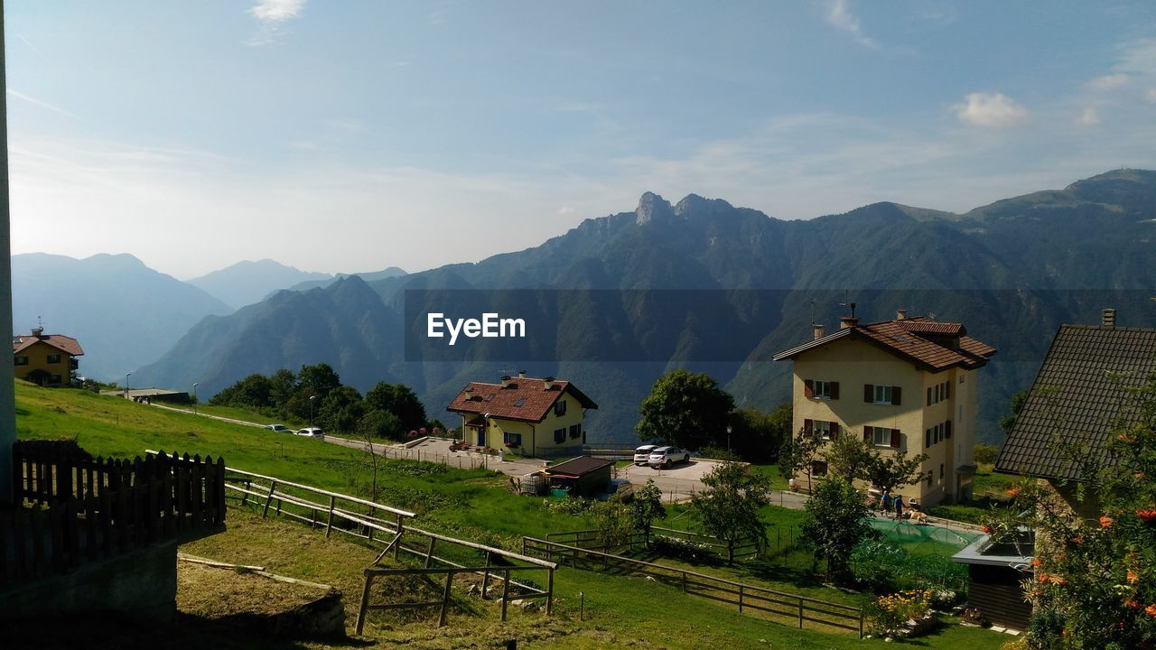 mountain, built structure, architecture, house, mountain range, building exterior, high angle view, sky, day, nature, scenics, outdoors, beauty in nature, no people, landscape