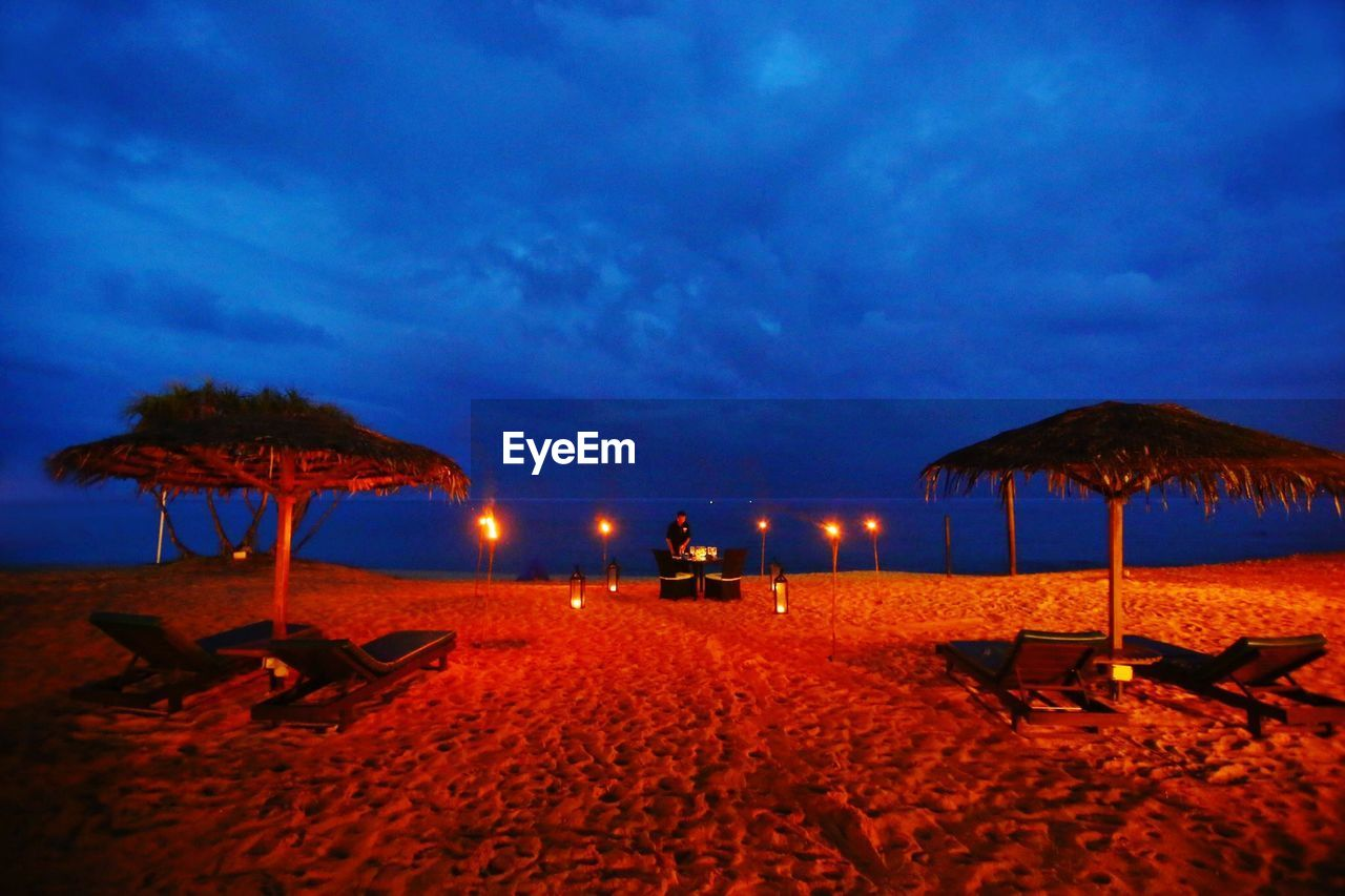 beach, sand, sky, cloud - sky, sea, outdoors, vacations, tranquility, tranquil scene, nature, illuminated, scenics, no people, beauty in nature, night, water