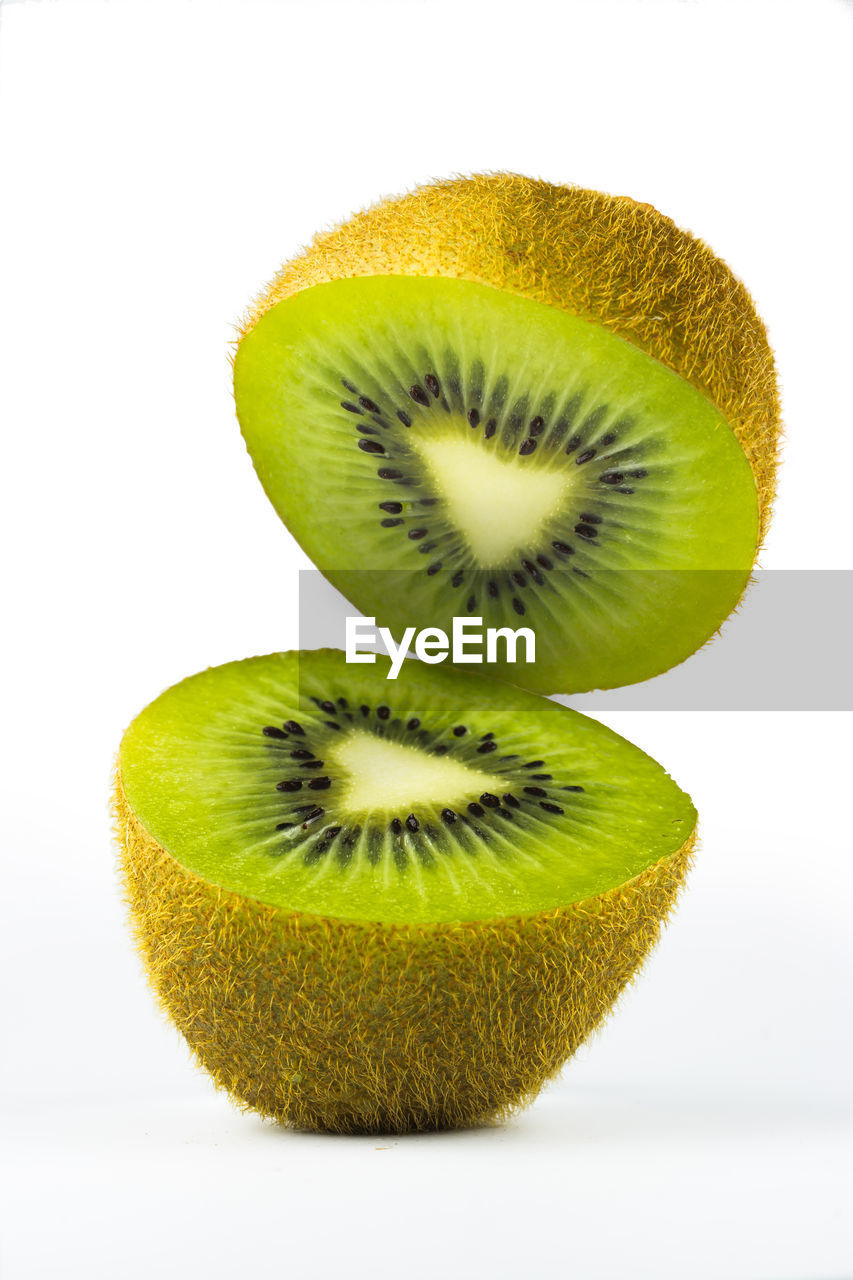 kiwi, studio shot, fruit, white background, healthy eating, kiwi - fruit, food and drink, slice, food, freshness, wellbeing, indoors, cut out, green color, cross section, close-up, no people, still life, healthy lifestyle, halved, ripe