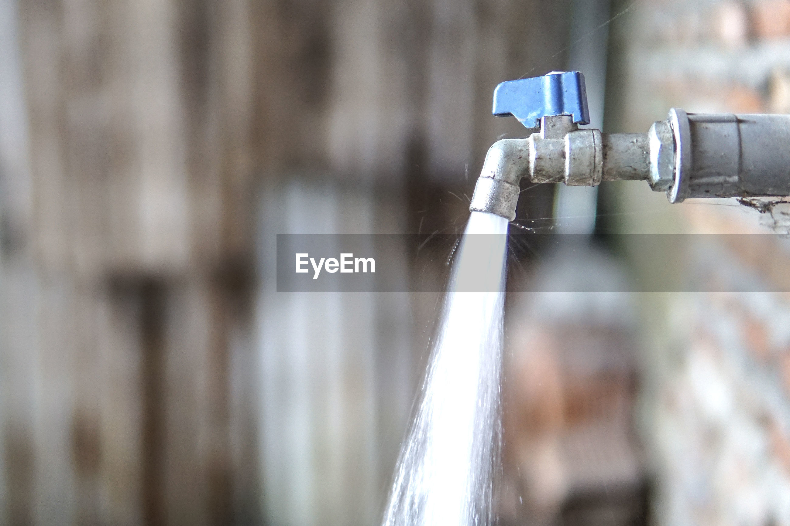 Close-up of running water coming out from faucet