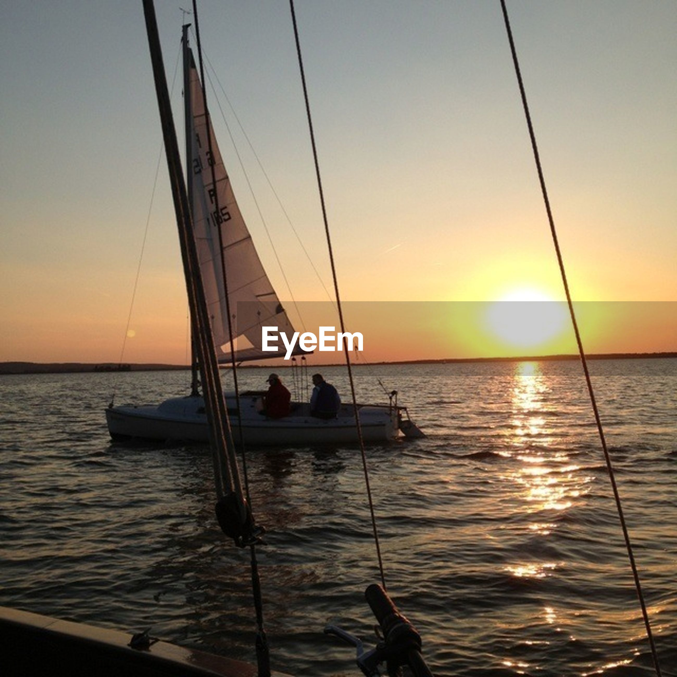 sunset, sea, water, horizon over water, orange color, nautical vessel, sun, scenics, transportation, beauty in nature, boat, tranquil scene, tranquility, sky, sailboat, idyllic, mode of transport, silhouette, nature, reflection