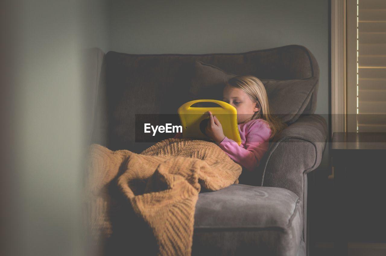 Girl playing on sofa