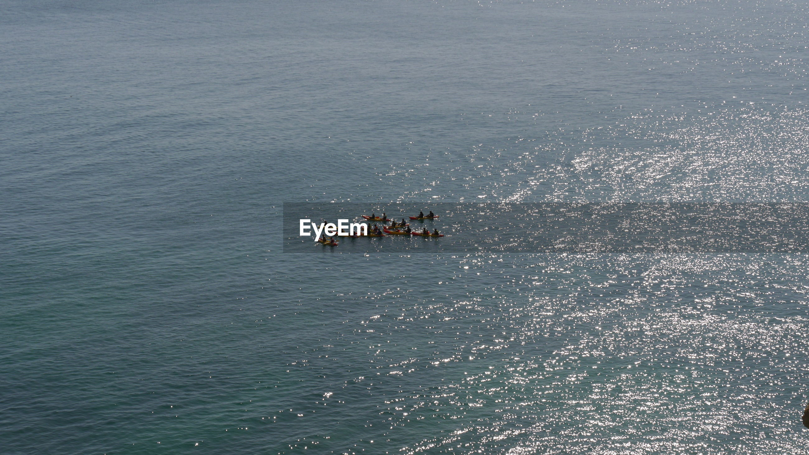 High angle view of people in conoes on sea