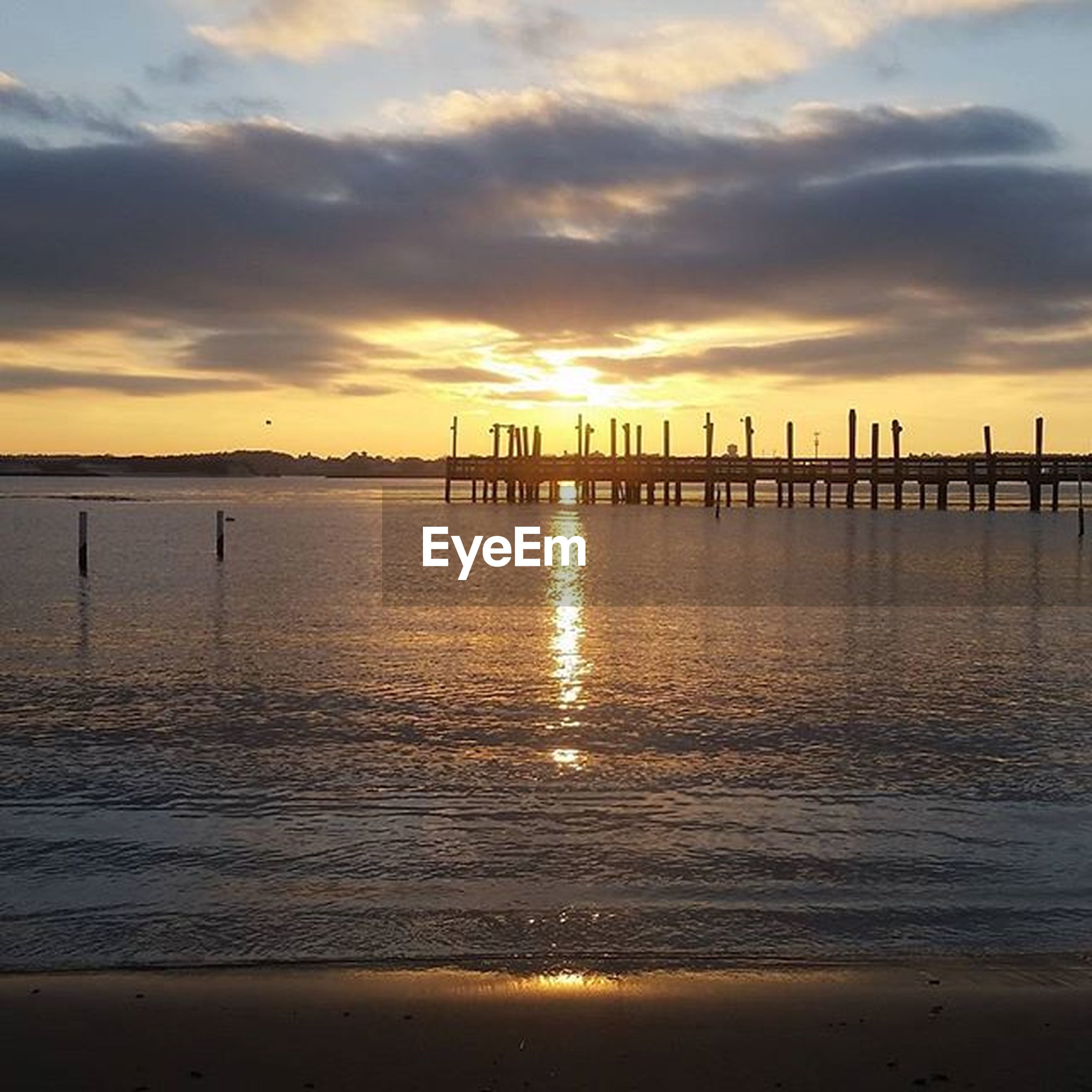 sunset, water, sea, sky, scenics, tranquil scene, tranquility, beauty in nature, pier, beach, silhouette, cloud - sky, nature, orange color, idyllic, reflection, wooden post, built structure, shore, horizon over water