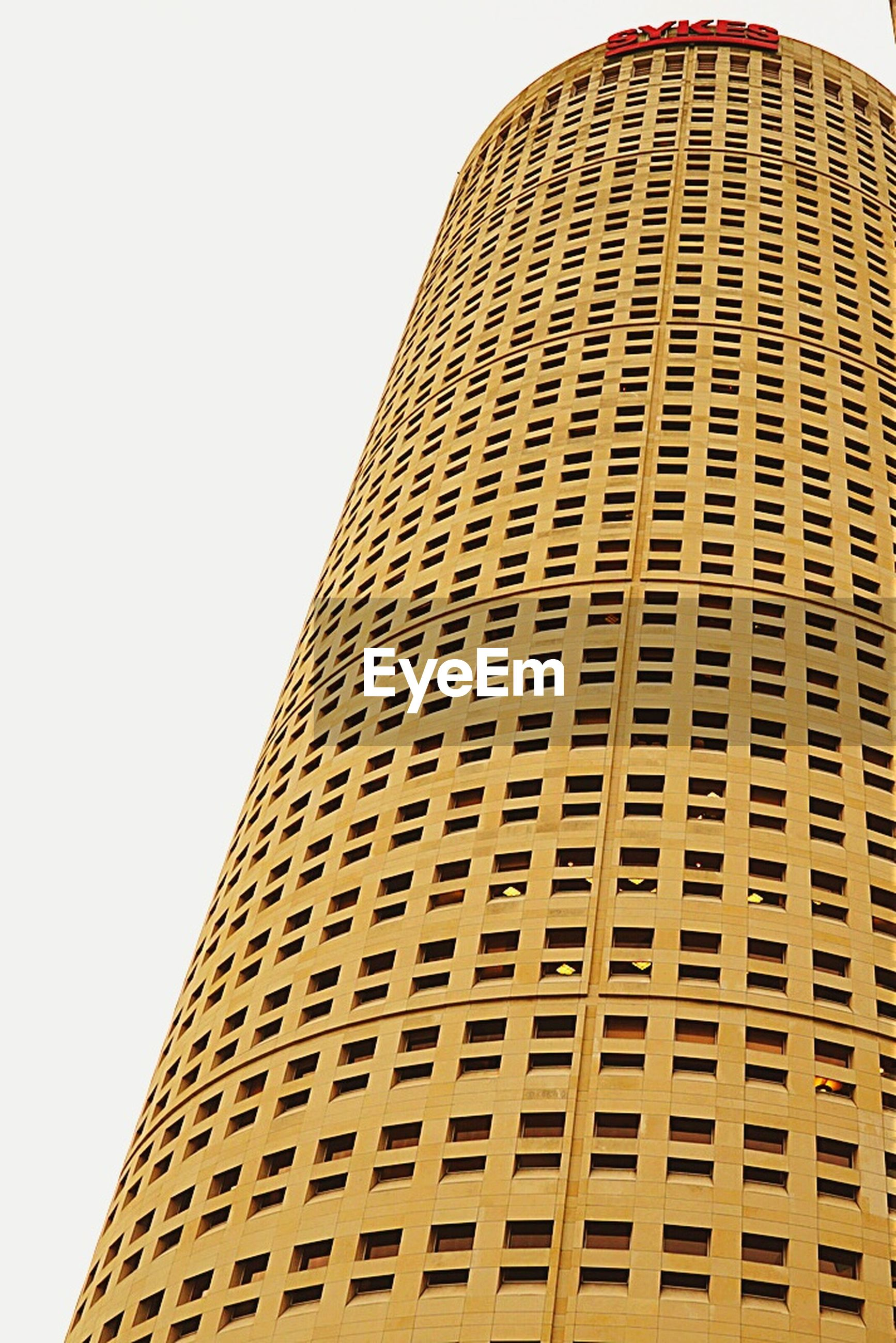 architecture, building exterior, built structure, low angle view, clear sky, tall - high, modern, tower, skyscraper, city, office building, building, day, tall, copy space, outdoors, no people, window, pattern, sky