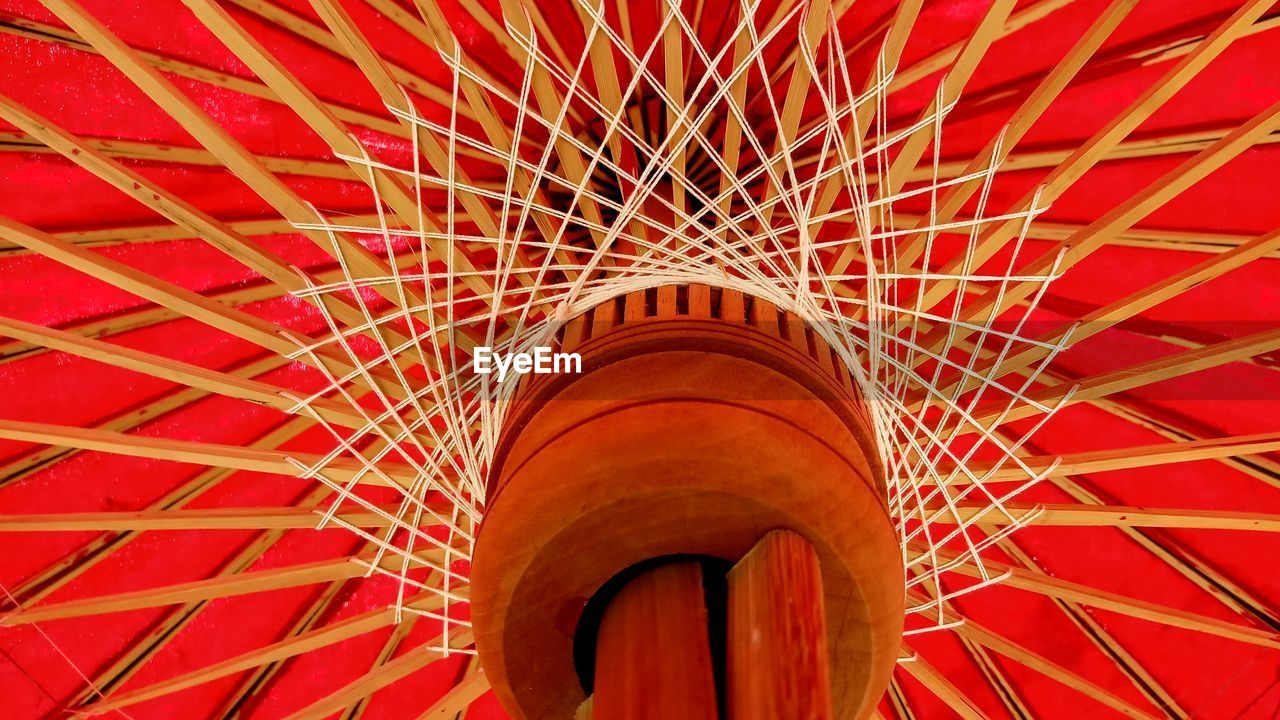 red, pattern, low angle view, no people, architecture, indoors, design, built structure, day, metal, full frame, close-up, backgrounds, security, protection, lighting equipment, circle, shape, directly below, ceiling, architecture and art
