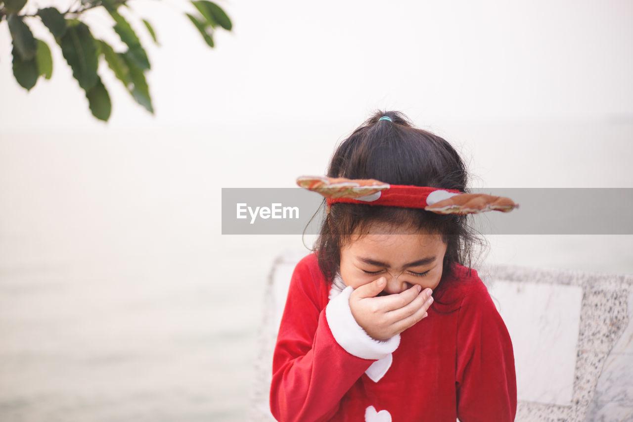 Happy girl wearing headband outdoors