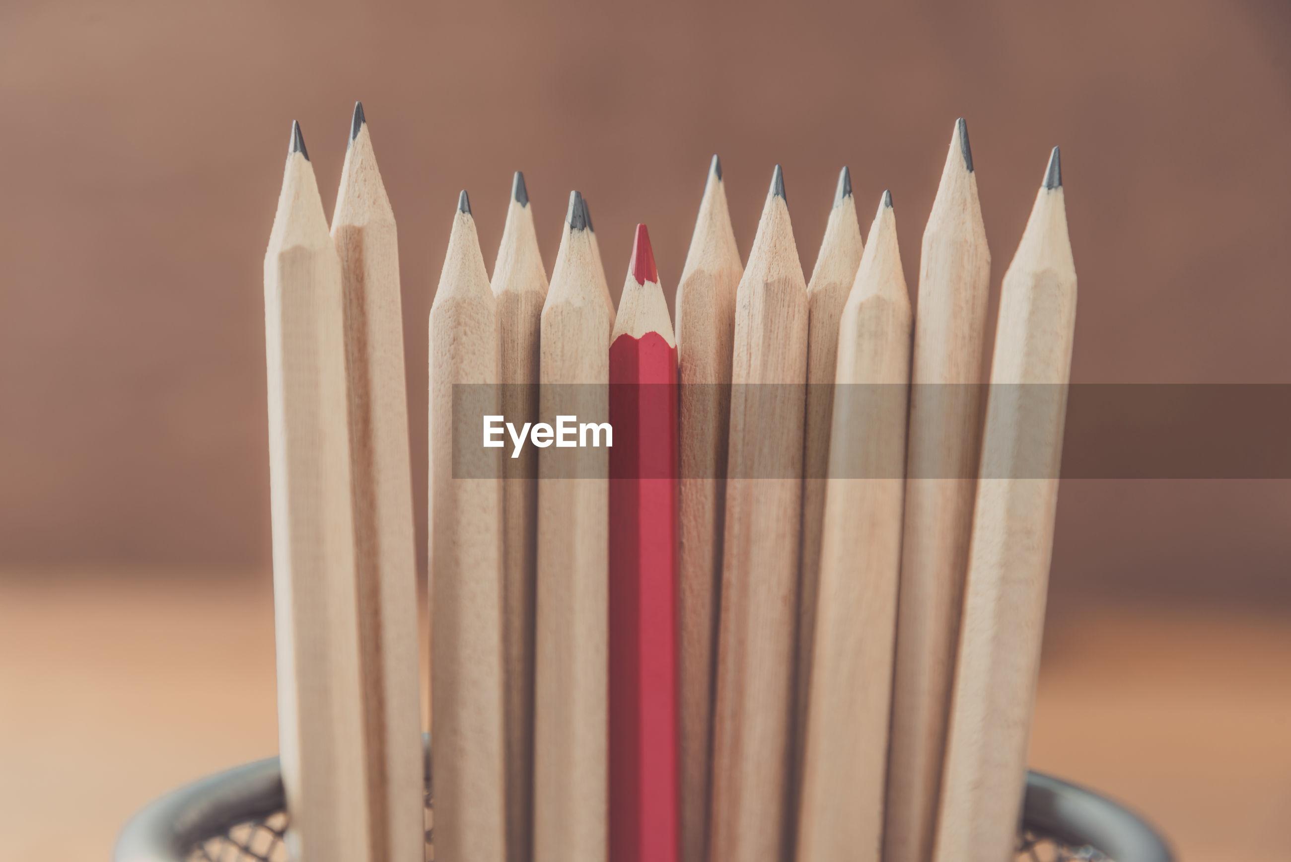 Close-up of pencils in metallic container
