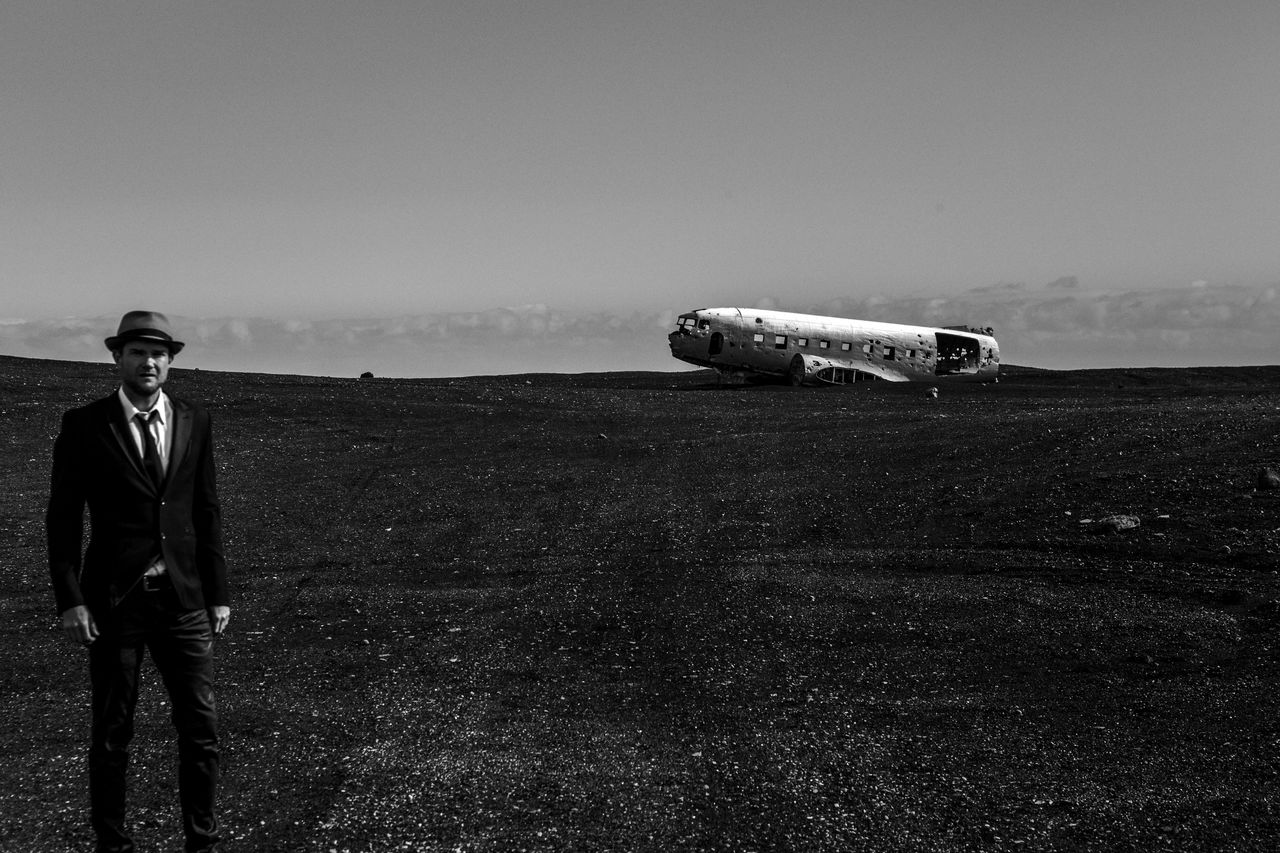 Portrait Of Man On Landscape With Abandoned Airplane