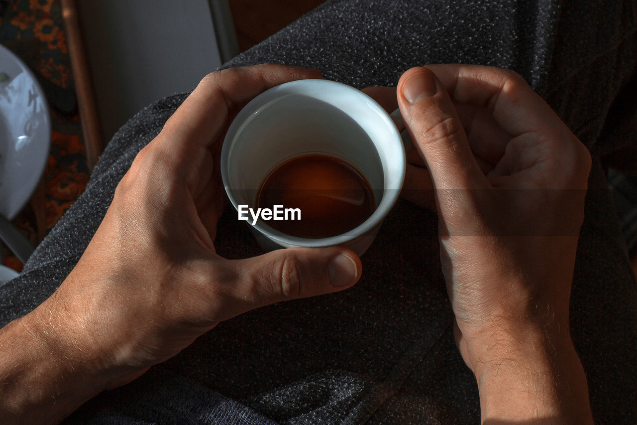 Cropped Image Of Hands Holding Drink