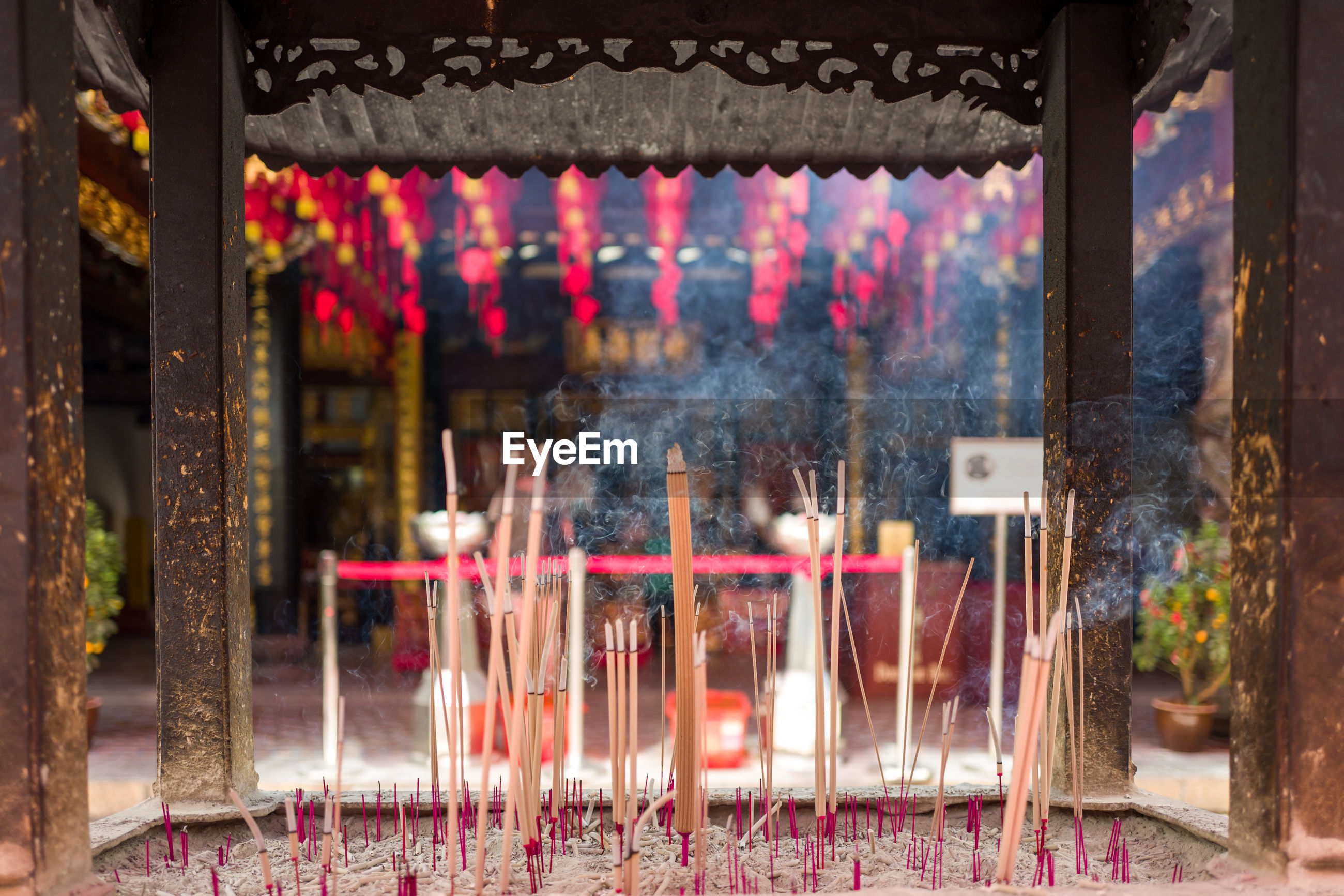 Incense sticks burning in temple