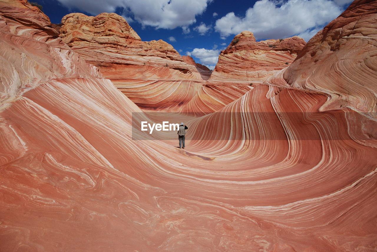 Full Length Of Man Standing On Desert Against Sky