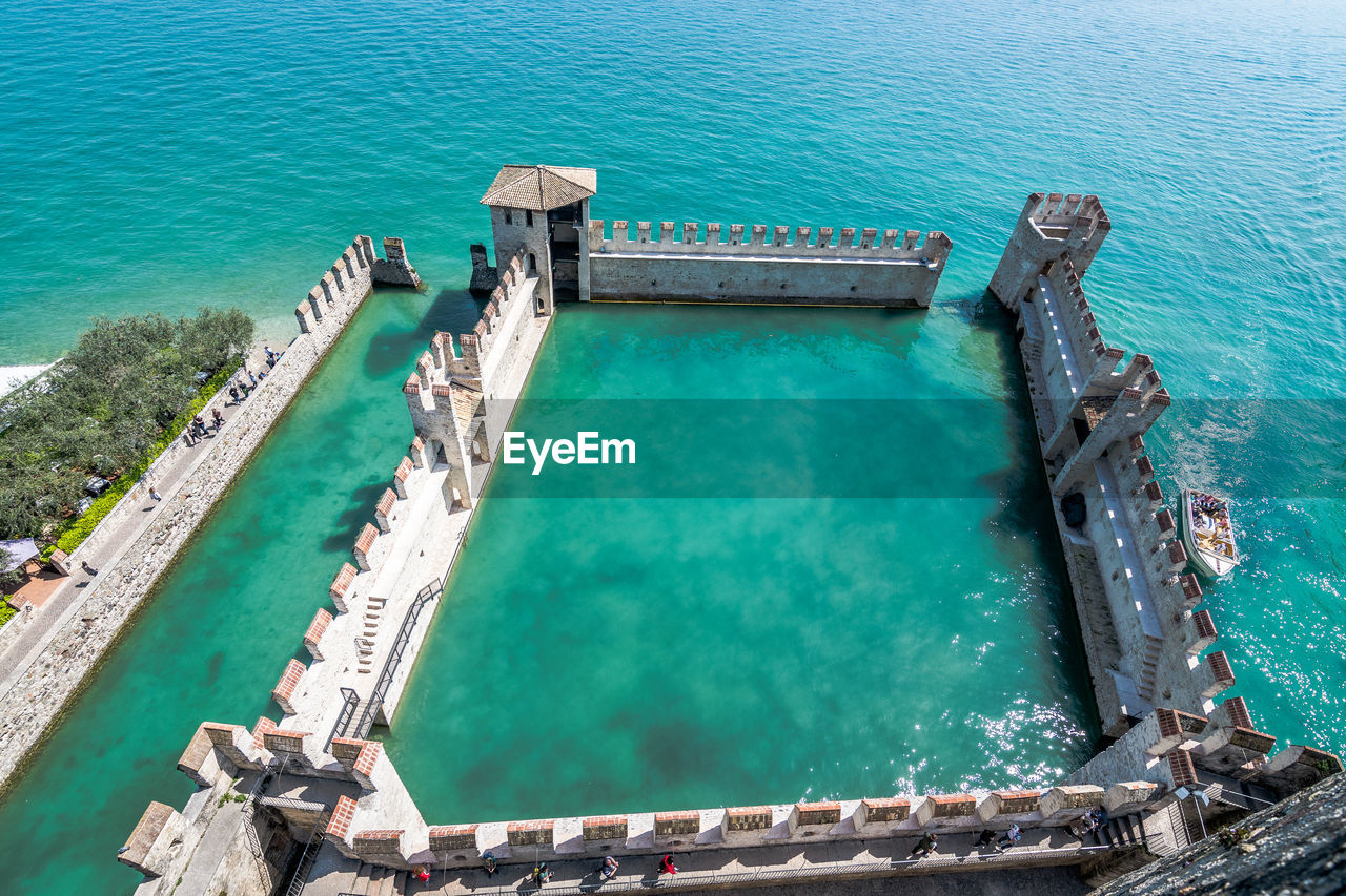 water, high angle view, turquoise colored, sea, day, nature, architecture, outdoors, no people, built structure, travel destinations, transportation, pool, swimming pool, pier, sunlight, scenics - nature, nautical vessel, tourism