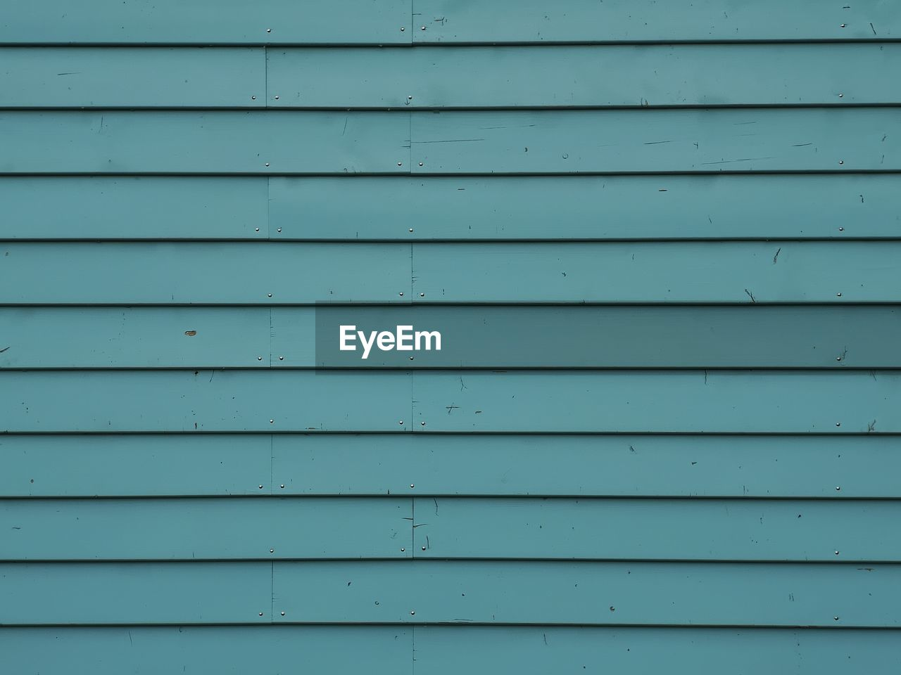 backgrounds, full frame, pattern, architecture, wall - building feature, no people, repetition, day, built structure, safety, outdoors, textured, wood - material, close-up, metal, security, protection, shutter, in a row, wall, corrugated, iron, turquoise colored, garage