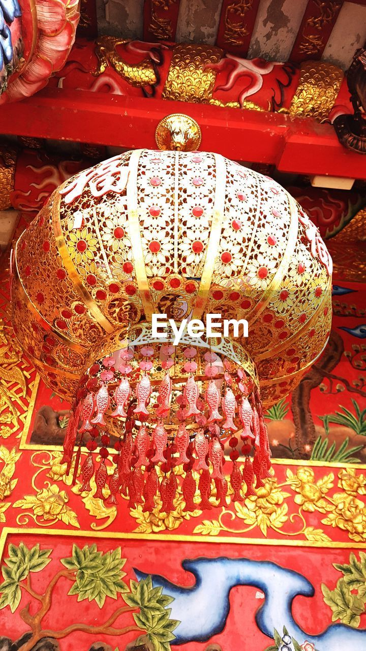 belief, religion, spirituality, place of worship, art and craft, indoors, no people, creativity, red, building, built structure, pattern, representation, craft, sculpture, architecture, ornate, festival, ceiling