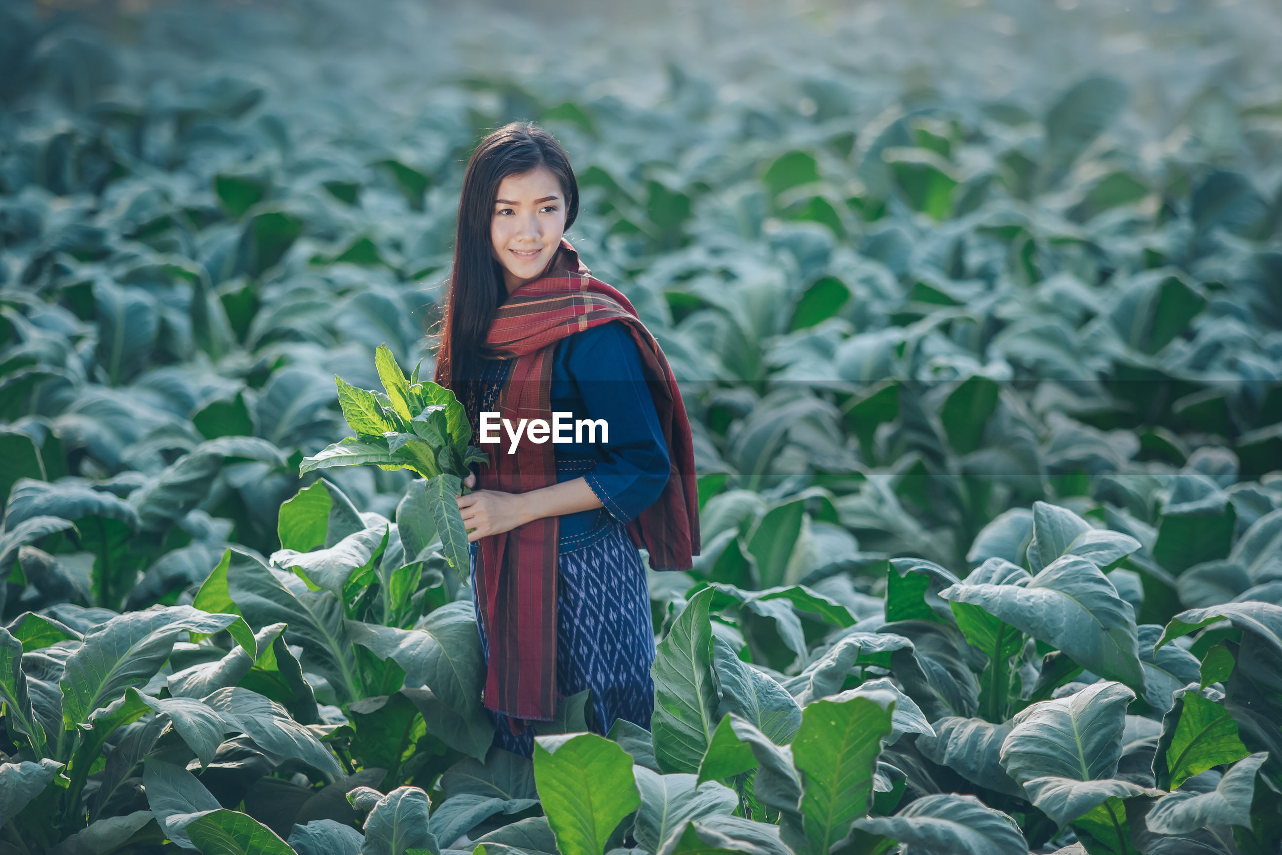 PORTRAIT OF WOMAN STANDING ON PLANTS