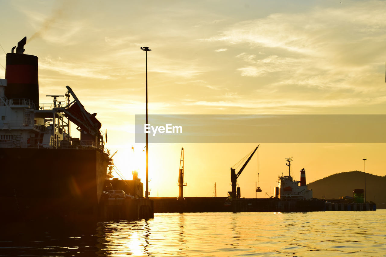 sunset, water, sky, industry, crane - construction machinery, machinery, cloud - sky, silhouette, pier, commercial dock, nature, no people, freight transportation, orange color, harbor, transportation, shipping, waterfront, architecture, outdoors, construction equipment