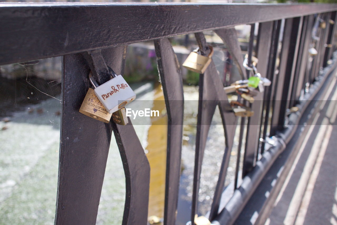 metal, padlock, lock, love lock, day, safety, text, railing, outdoors, protection, communication, bridge - man made structure, transportation, no people, luck, hanging, close-up, hope
