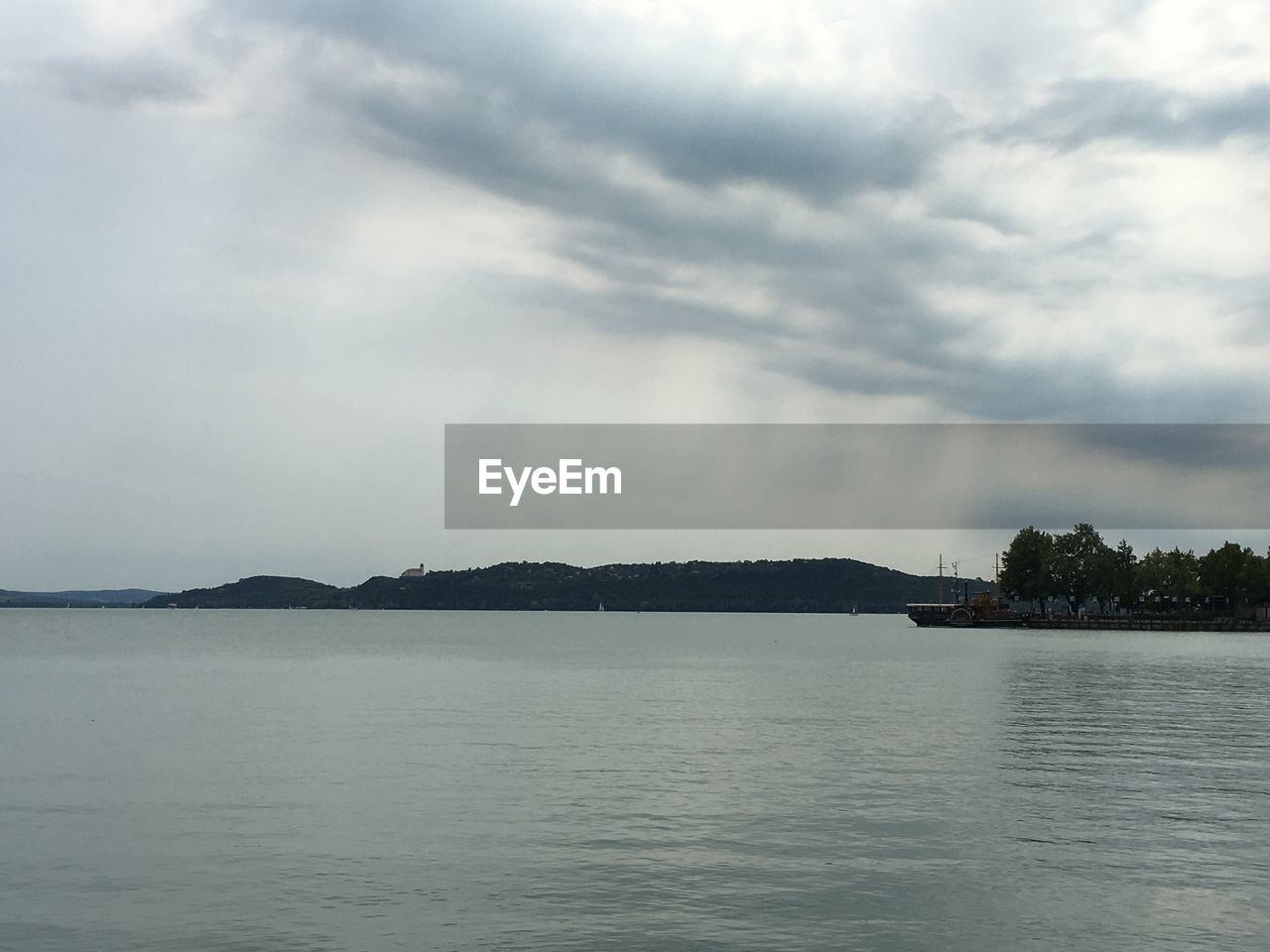 sky, cloud - sky, water, waterfront, scenics - nature, beauty in nature, tranquil scene, tranquility, nature, sea, no people, day, overcast, idyllic, outdoors, tree, non-urban scene, ominous