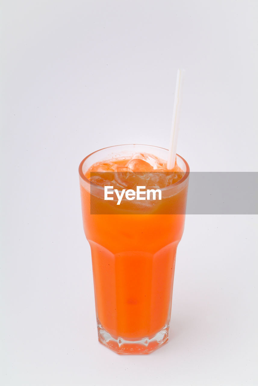 studio shot, drink, drinking straw, straw, orange color, glass, refreshment, food and drink, white background, still life, drinking glass, household equipment, food, indoors, healthy eating, cut out, fruit, freshness, no people, close-up, orange, non-alcoholic beverage, fruit juice