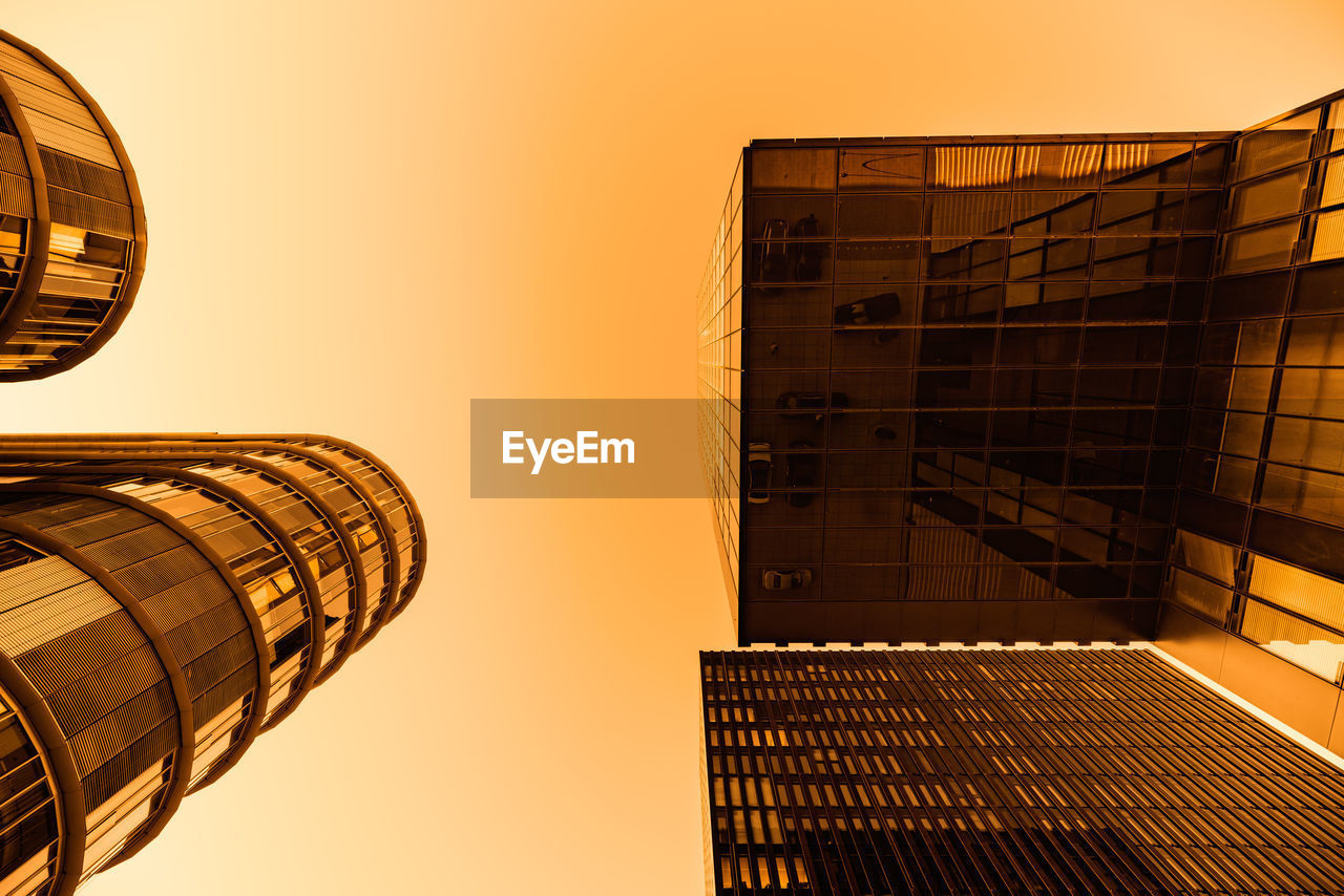 architecture, built structure, building exterior, sky, building, city, clear sky, nature, office building exterior, low angle view, no people, sunset, modern, tower, tall - high, office, skyscraper, outdoors, orange color, reflection, directly below