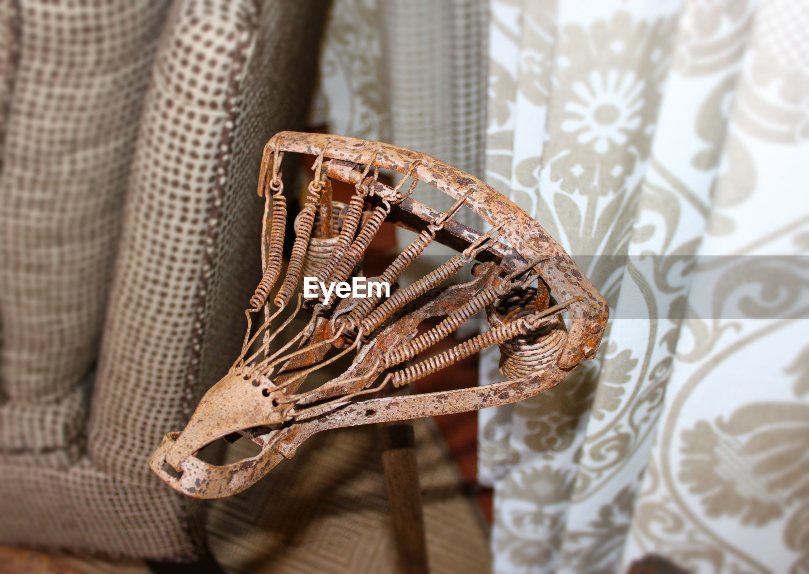 High angle view of rusty bicycle seat at home