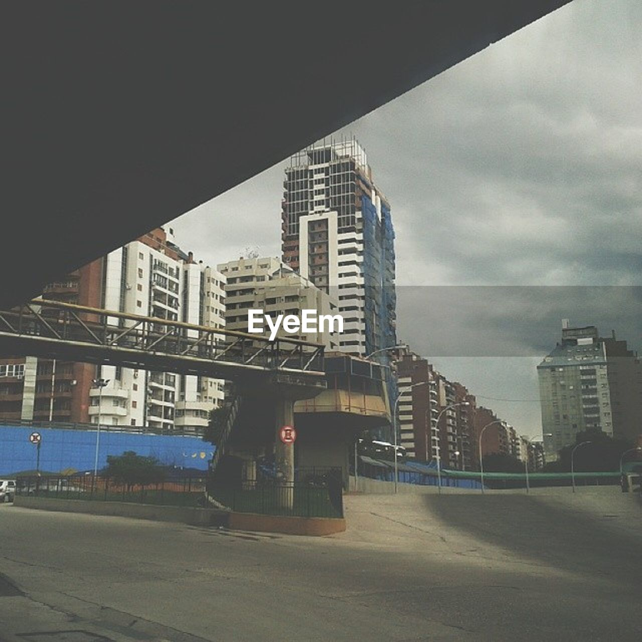 architecture, built structure, skyscraper, city, building exterior, road, modern, bridge - man made structure, outdoors, sky, day, transportation, travel destinations, no people, cityscape