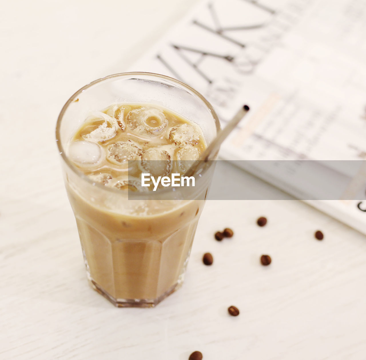 HIGH ANGLE VIEW OF COFFEE WITH GLASS ON TABLE