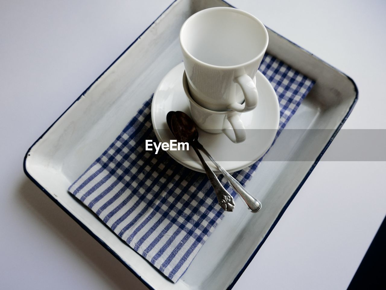 coffee cup, coffee - drink, food and drink, saucer, refreshment, still life, table, drink, high angle view, no people, indoors, close-up, freshness, napkin, white background, day