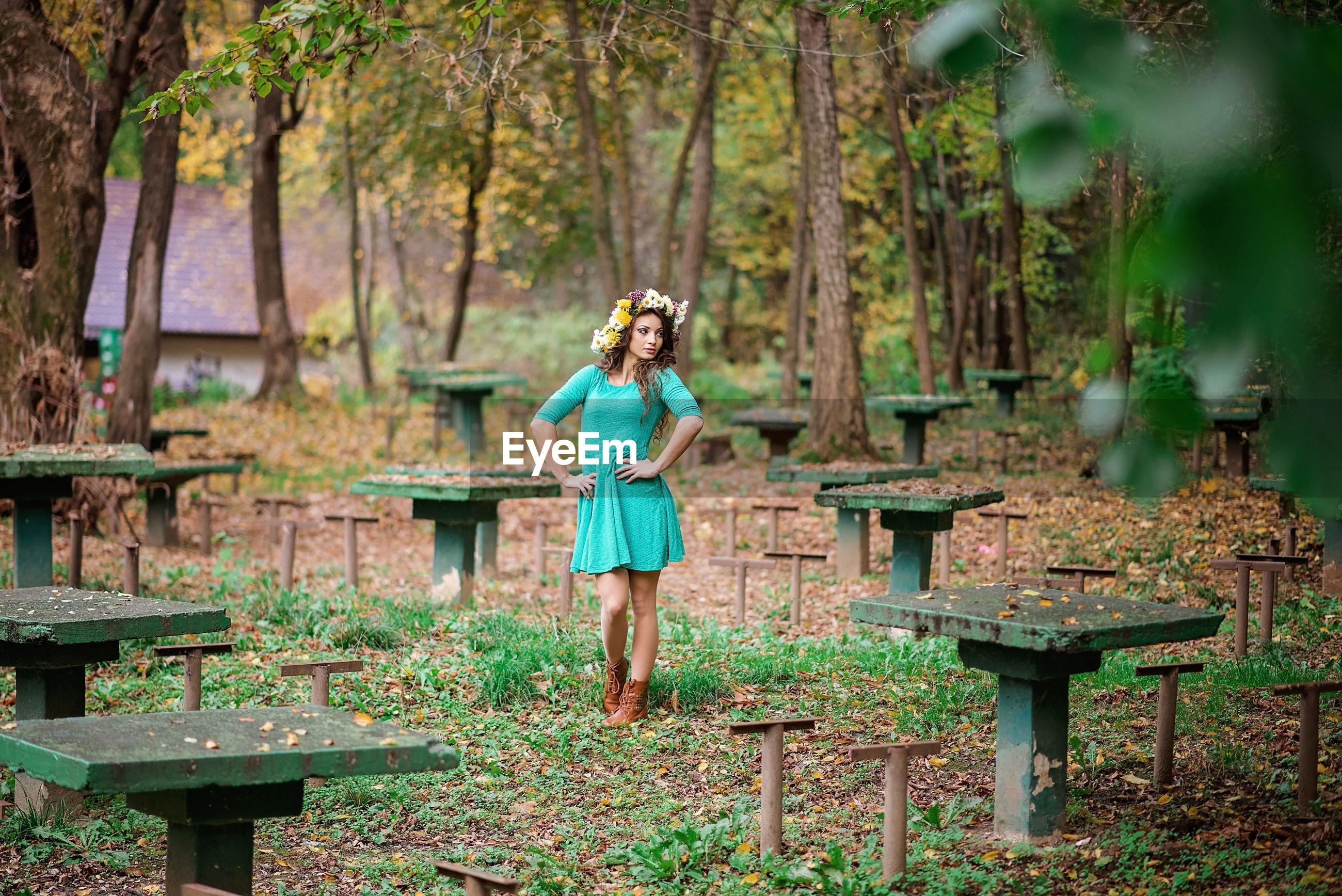 Full length of man standing on table against trees