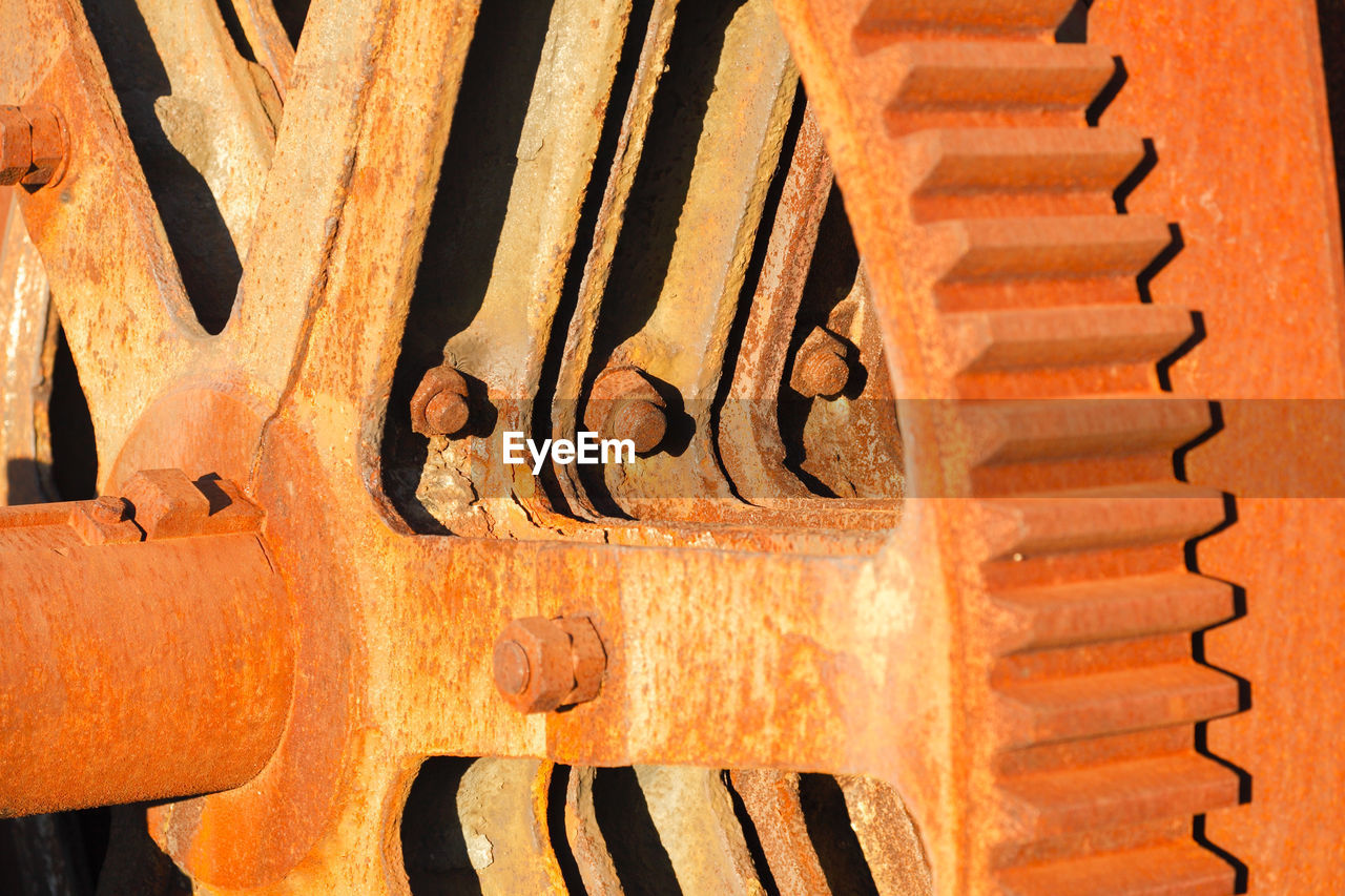 full frame, pattern, backgrounds, metal, close-up, brown, no people, rusty, day, wood - material, orange color, sunlight, design, textured, shape, old, indoors, wall - building feature, focus on foreground