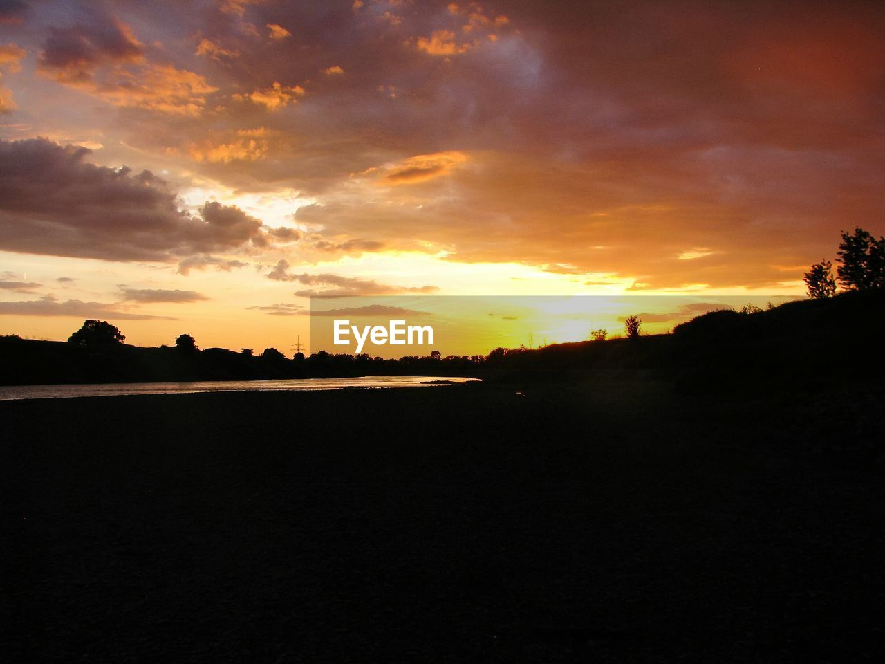 sunset, sky, cloud - sky, silhouette, tranquility, beauty in nature, tranquil scene, scenics - nature, orange color, nature, environment, landscape, no people, idyllic, non-urban scene, land, sun, outdoors, tree, dramatic sky