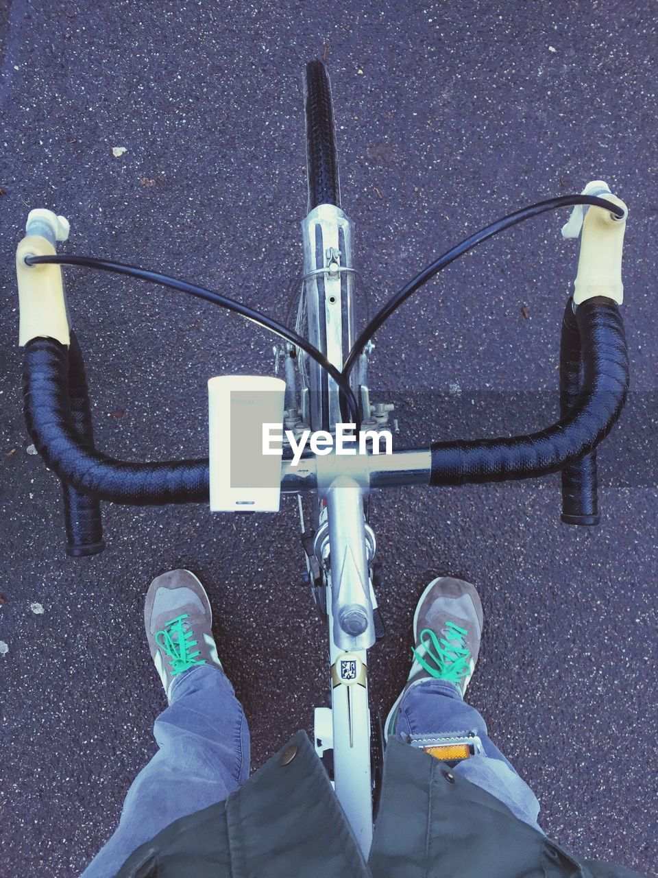 low section, bicycle, transportation, personal perspective, human leg, handlebar, real people, street, road, shoe, mode of transport, outdoors, day, human body part, standing, unrecognizable person, land vehicle, high angle view, cable, men, directly above, human hand, lifestyles, close-up, people
