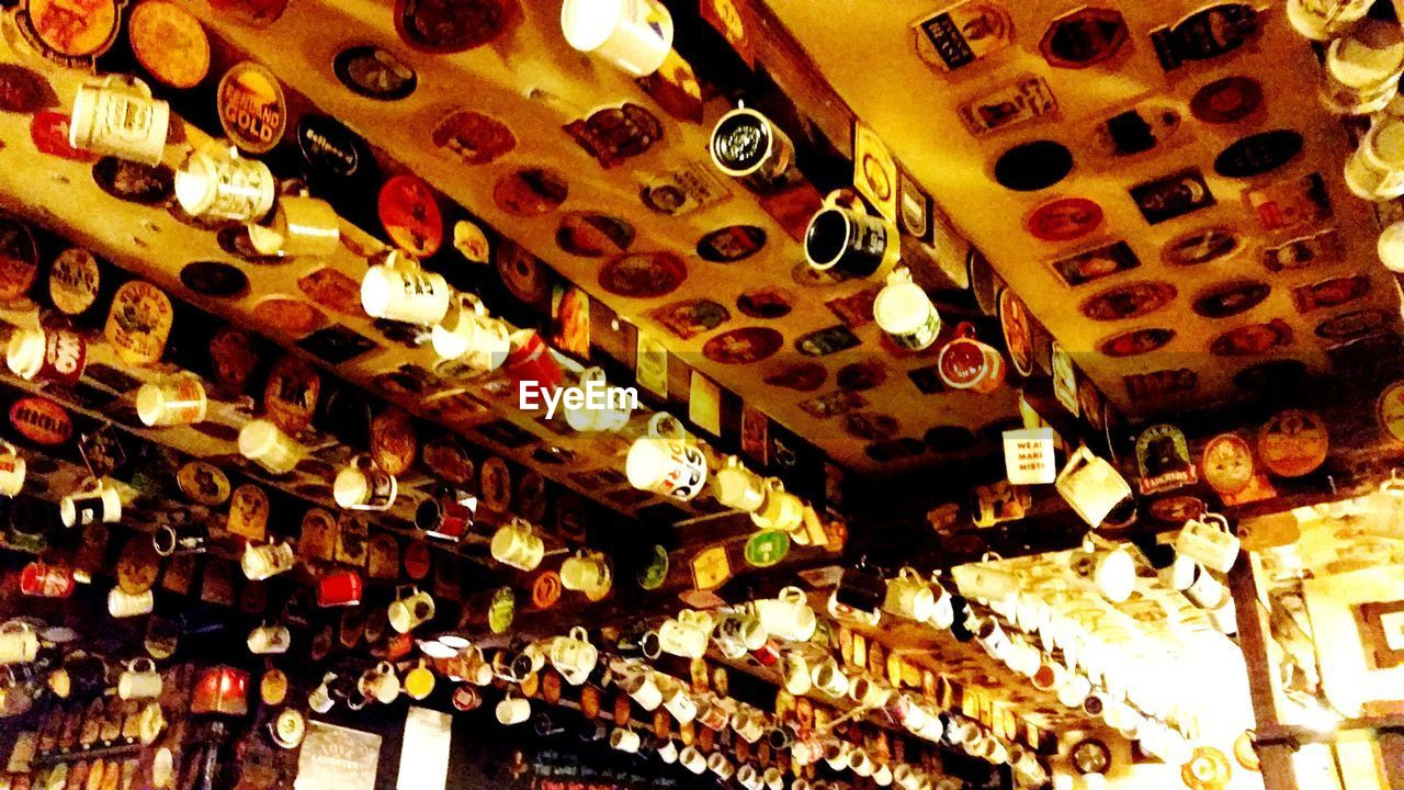 Low Angle View Of Cups Hanging On Ceiling In Restaurant