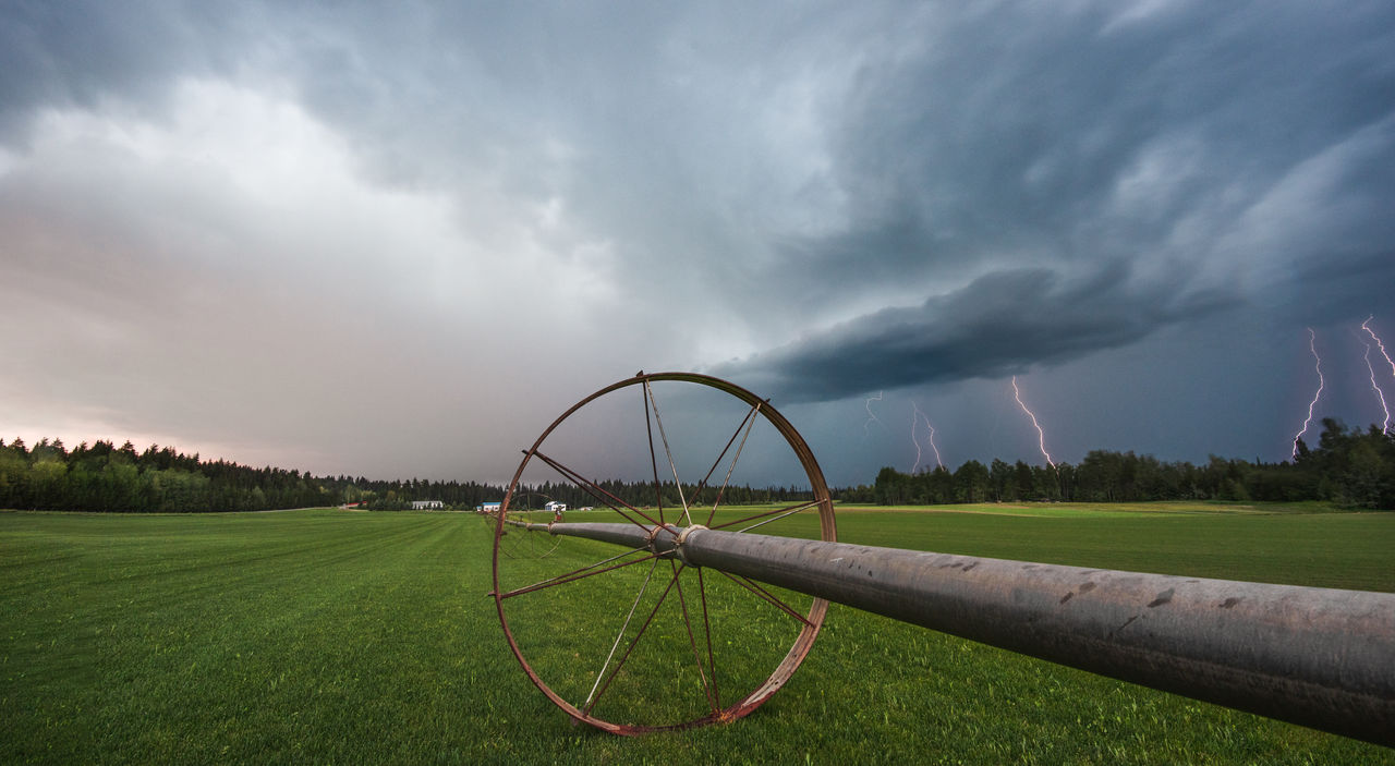 Cart On Field Against Sky