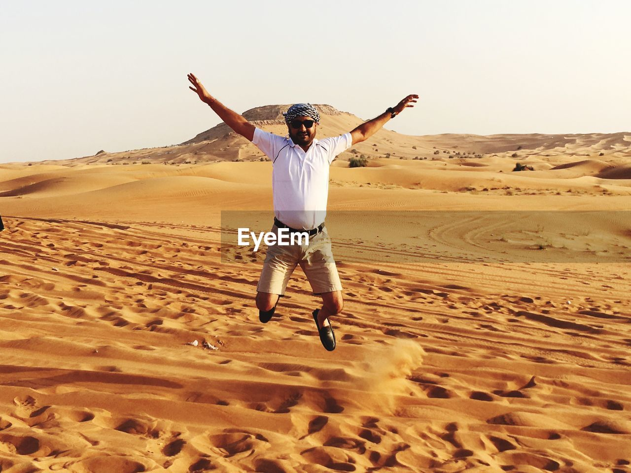 Full length of man jumping in desert