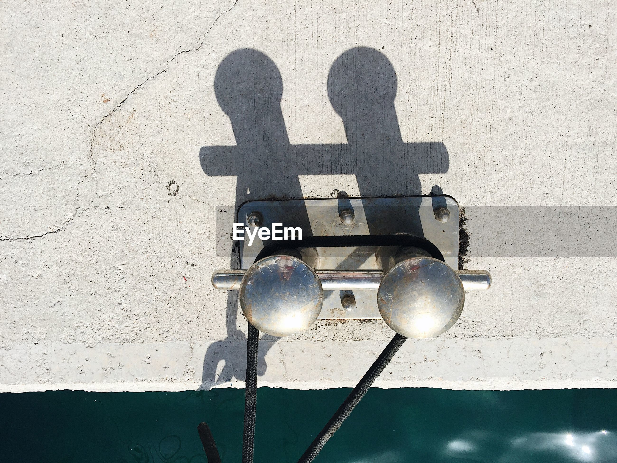 Directly above view of cleat on pier