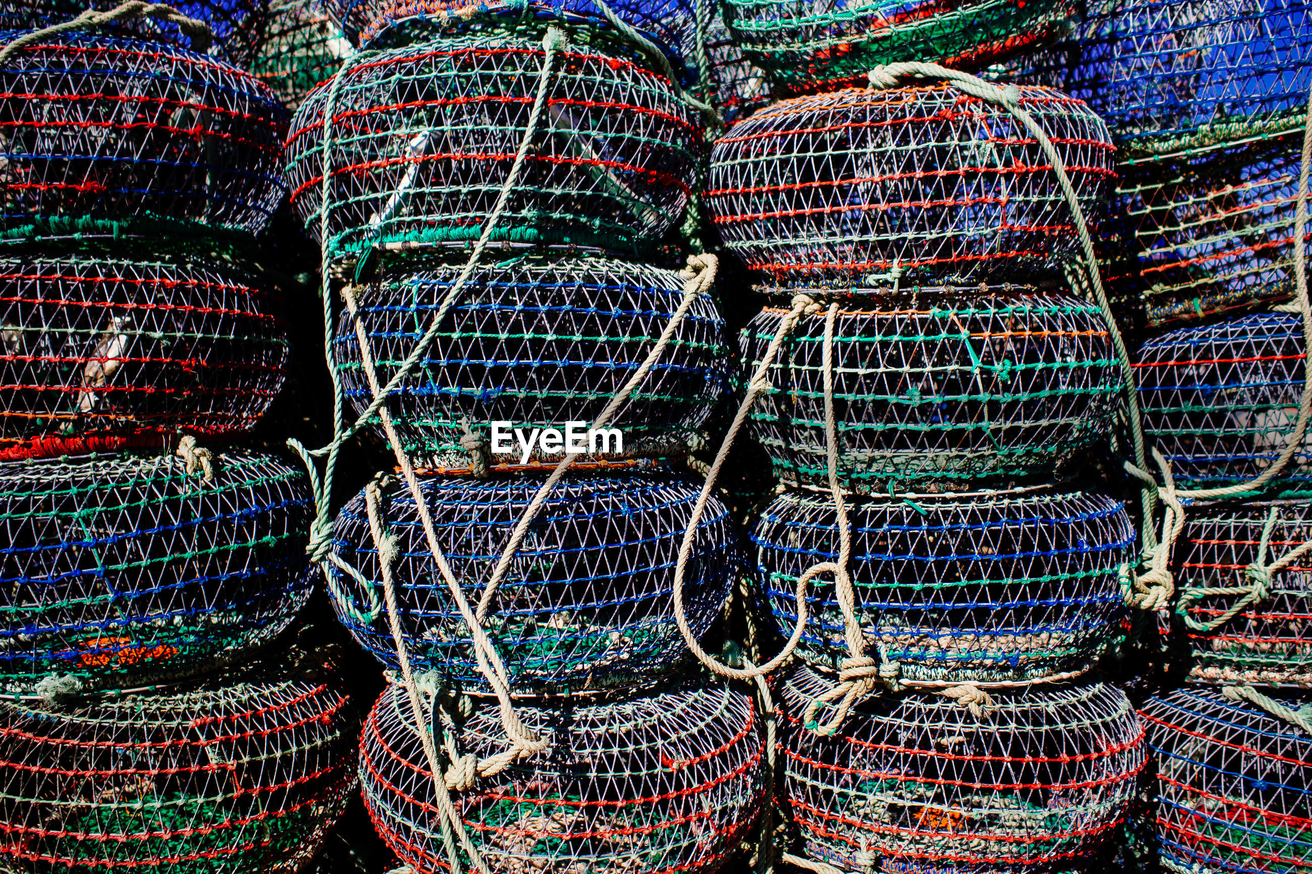 Full frame shot of fish traps stacked outdoors