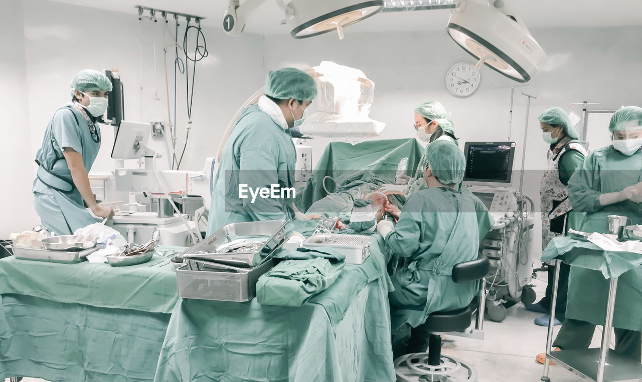 Doctors working in operating room at hospital