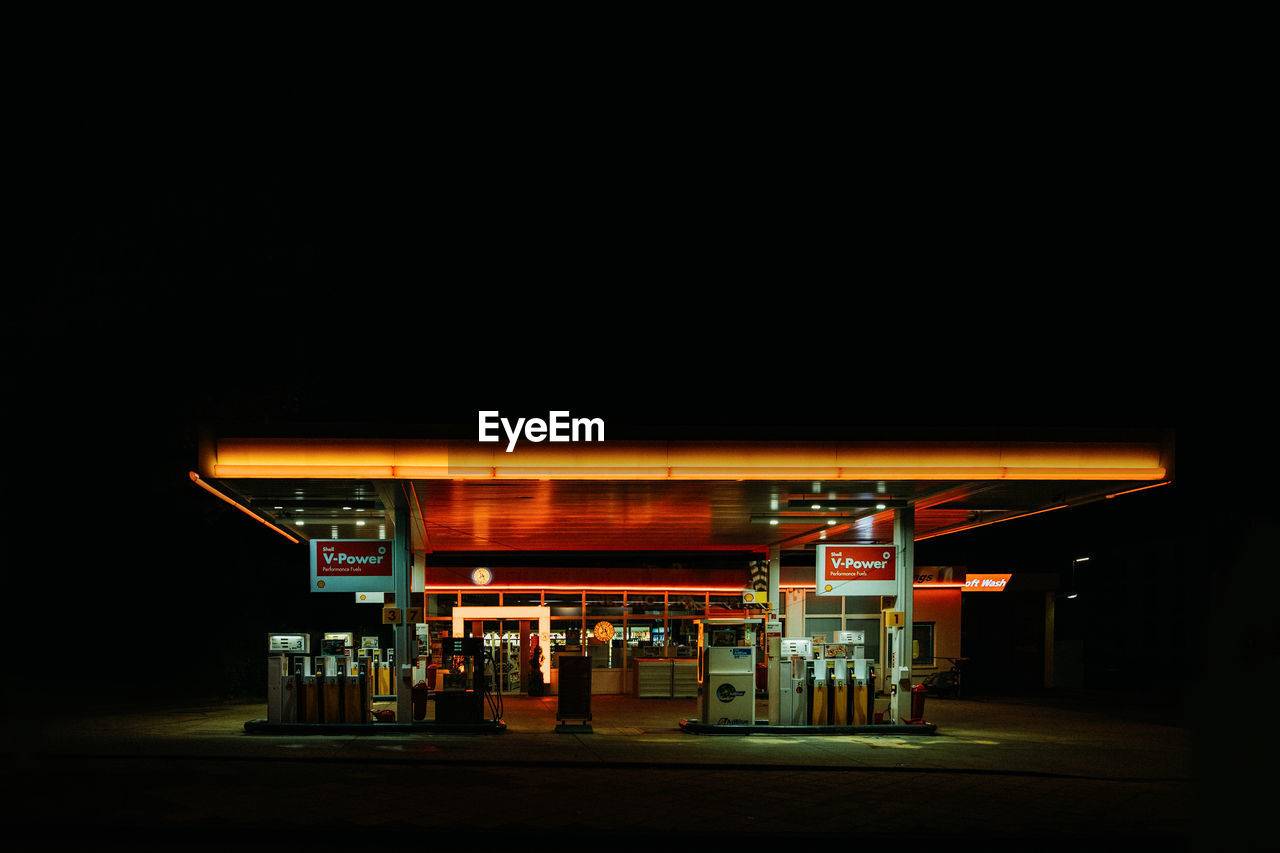gas station, fuel pump, refueling, night, copy space, fuel and power generation, gasoline, illuminated, no people, architecture, filling, dark, built structure, sign, outdoors, communication, absence, fossil fuel, store, neon, consumerism, nightlife, station