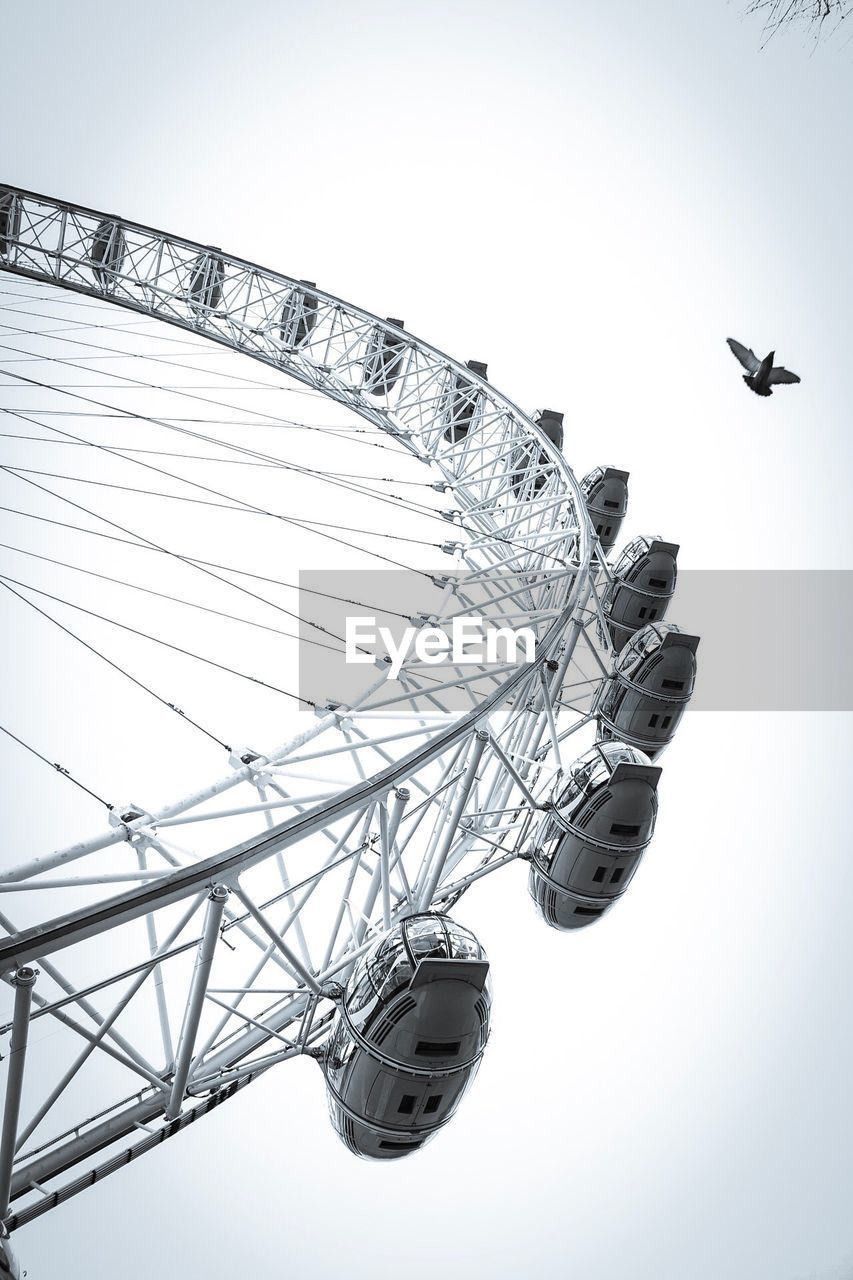 amusement park, ferris wheel, arts culture and entertainment, amusement park ride, low angle view, clear sky, big wheel, no people, day, outdoors, sky