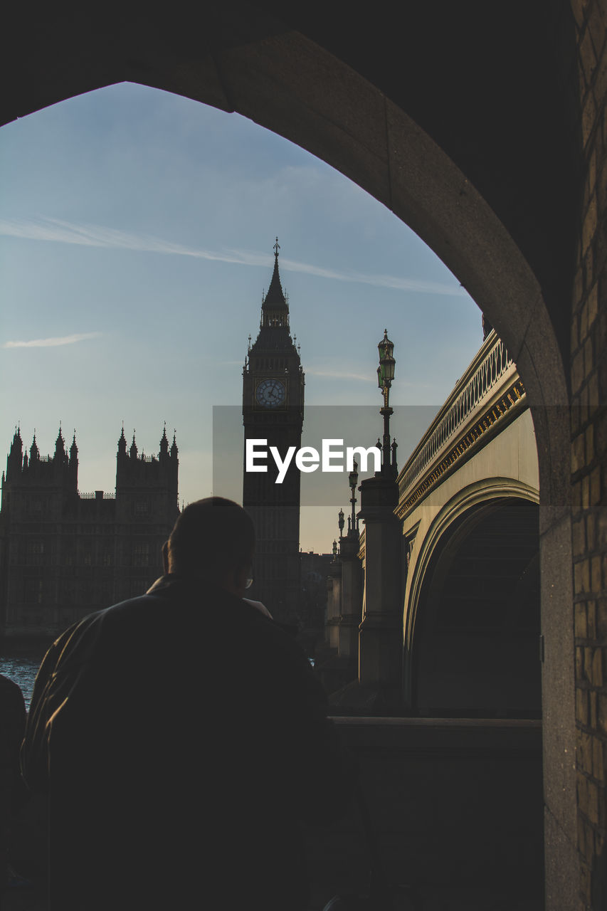 Rear view of man standing against big ben